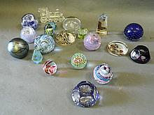 A collection of glass paperweights