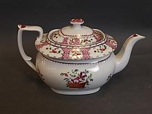 An English teapot decorated with puce flowers, 6