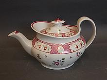 An English teapot with pink and iron red flowers,