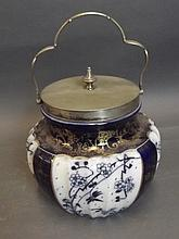 A Royal Doulton blue ground biscuit barrel with