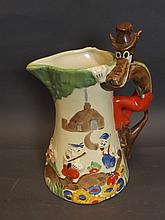 An early C20th English pottery jug depicting the