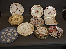 A quantity of various hand painted plates,