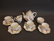 A Coalport tea service painted with summer
