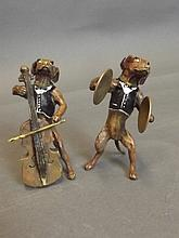 Two cold painted bronze dog musicians in dinner