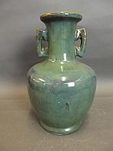 A Chinese twin handled green ground drip glazed