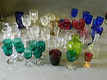 A quantity of cut and coloured drinking glasses