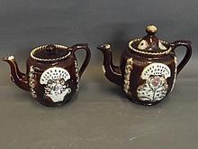 Two small Bargeware teapots with raised flower
