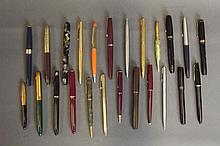 A quantity of fountain pens and propelling pencils