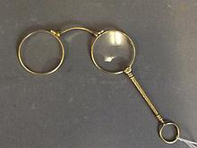 A pair of gilt rimmed pocket Lorgnettes, 4¼