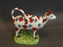 An early Staffordshire pearlware cow creamer with