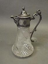 A Victorian silver plate and cut glass claret jug