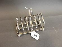 A Hallmarked silver toast rack, Sheffield 1911/12,