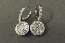 A pair of 18ct white gold diamond drop earrings,