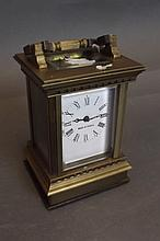 A brass bound carriage clock, 4