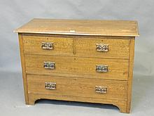 An Edwardian solid oak chest of drawers with Art