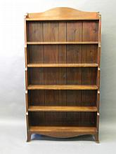 An Edwardian mahogany waterfall bookcase on swept