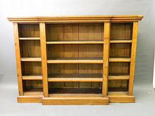 A Victorian oak breakfront open bookcase with