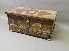 A good antique Eastern teak chest with ornate