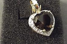 A 9ct gold smoky quartz and diamond heart shaped