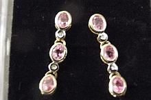 A pair of 9ct gold, pink sapphire and diamond drop