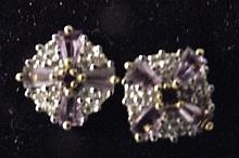 A pair of 9ct gold amethyst and diamond stud