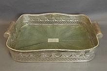 A large silver plate and faux shagreen tray with