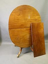 A rare Regency mahogany oval tilt top extending