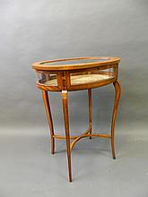 A Victorian inlaid satinwood oval bijouterie table