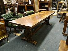 A large early C20th solid oak refectory dining