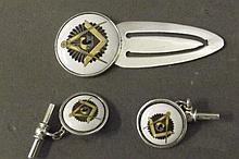 A pair of silver cufflinks and money clip with