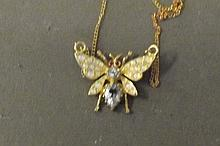 A silver and gold plated necklace in the form of a