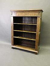 A Victorian carved oak open bookcase, 36