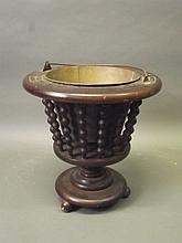 A C19th mahogany jardinière on a pedestal base