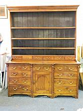 A good early C19th solid walnut breakfront