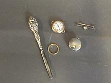 A gold watch, a 9ct wedding band, pill box etc