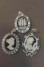 Three silver plated cameo pendants