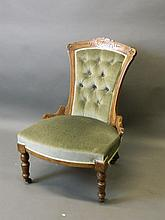 A Victorian walnut nursing chair on turned