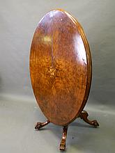 A Victorian figured walnut oval loo table with