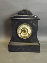 A Victorian slate mantle clock, 14