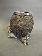 A C19th Indian carved coconut with silver plated