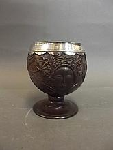 A C19th silver mounted carved coconut goblet, 4¼