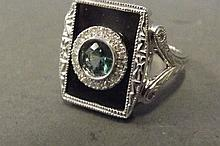 A 14ct white gold, emerald and onyx set with