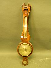 A C19th inlaid mahogany glass wall barometer, 39