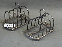 Two similar Hallmarked silver toast racks, 206g