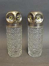 A pair of silver plate and cut glass jars in the