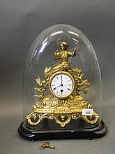 A C19th gilt spelter mantle clock decorated with
