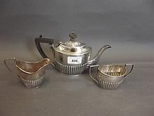 A three piece Hallmarked silver tea service,
