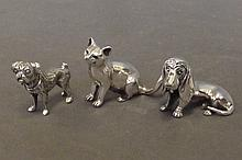 Three Continental silver models of a cat and two