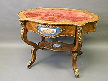 A superb C19th French kingwood shaped centre table