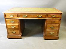 A Victorian walnut 9 drawer pedestal desk with a